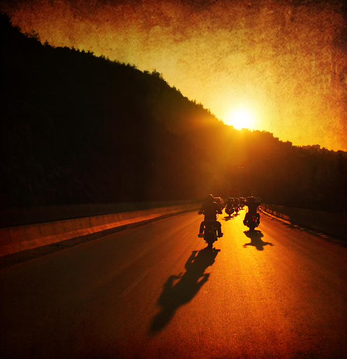Motorcycle riders in the sunset.jpg